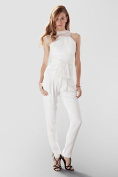 Sleek illusion cowl, hand-draped top paired with a slim fit pant. Outfit by Aideaux.