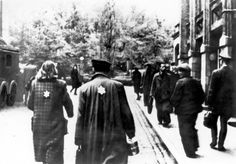 Lodz, Poland, Jews wearing the Jewish badge in the ghetto.
