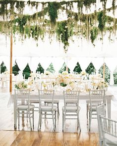 Take cover on the big day in style, and think of your wedding reception tent as a blank canvas ready to be filled to suit your occasion. To get inspired, turn to these examples from celebrations and get ready to reach for the stars (or chandeliers or flowers or lights!).     Hanging Garlands  Inside the reception tent at this Virginia wedding, swags of maidenhair ferns, moss, and roses were strung above the dance floor.