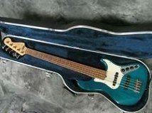 Teal 5 string Fender Jazz Bass.