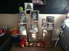 Angry bird Star Wars party DIY slingshot ( PVC pipe) $1 store wrapping paper on different boxes with pictures my son colored. Angry bird plushes to knock down ....cheap, easy, kids had ton fun knocking down!