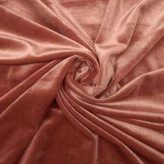 Stretch velvet fabric is stretchy velvet fabric is great for apparel, costumes, dance wear, decorations and more. The velvet has a silky soft feeling and a stretch. Its extra wide width also mak Textiles, Stunning Dresses, Pink Aesthetic, Fabric Material, Velvet Material, Stretch Fabric, Stretches, Peach, Colours