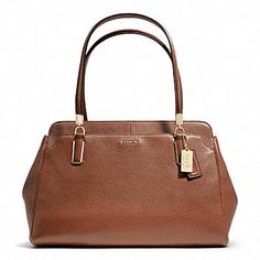 Coach, but it looks vintage and it doesn't have the C pattern. I like :)