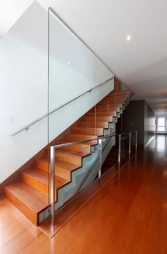 Full height glass balustrade.  Handrail on wall.  Minimal glass fixing