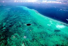 The Great Blue Hole, Belize. One of the world's most famous dive sites, the submarine sink-hole is over 300 metres (984 ft) across and 124 metres (407 ft) deep and lies near the center of Lighthouse Reef, 70 kilometres (43 mi) off the coast of Belize.