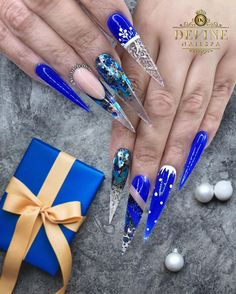"""NailsbyAndy on Instagram: """"""""I'll have a blue Christmas without you"""" 💙❄️ . Nails by Andy @ Devine Nailspa - Plano ▪️ 7965 Custer Rd, Suite 106, Plano, TX 75025 ▪️ 972 618…"""" Cute Christmas Nails, Xmas Nails, Holiday Nails, Blue Christmas, Rhinestone Nails, Bling Nails, Stiletto Nails, Gem Nails, New Year's Nails"""