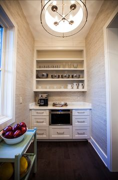 Butler's Pantry. Butler's Pantry Ideas. Inspiring Butler's Pantry Design with custom cabinets. Raffia wallpaper brings texture to this Butler's Pantry. #ButlersPantry #ButlersPantryDesign .