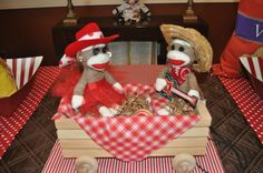 """Little wooden wagons make great transportation for sock monkey, especially when lined with fabric or bandana squares and filled with shredded paper """"hay."""""""