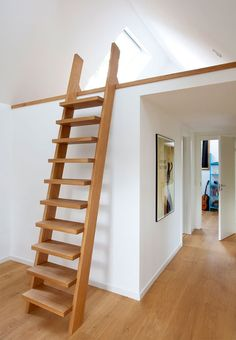 Carpenter built latter to the bed-loft in a beautiful and warm-coloured type of wood.