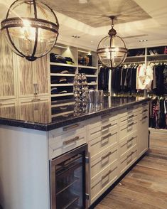 Now this is a dream walk-in closet that includes a beverage cooler! Dream closet. Custom closet ideas
