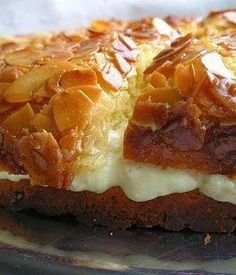 """Bee Sting Cake or """"Bienenstich"""" is a traditional German dessert that has the texture of pastry but a wonderful sweetness of honey. It is perfect for a breakfast treat or by itself with a cup of tea or coffee. Ask Chef Dennis German Bee Sting Cake, Traditional German Desserts, Bienenstich Recipe, Delicious Desserts, Yummy Food, Honey Cake, Chocolate Chip Muffins, Cakes And More, Tasty Dishes"""