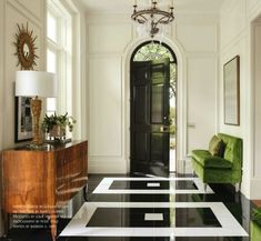 Paint the walls white and door black. Put this on the floor in paint in the front entryway. Yeah, it will work!