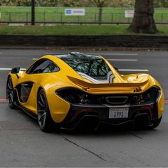 McLaren P1 painted in Volcano Yellow w/ exposed Carbon Fiber   Photo taken by: @bd.automotive on Instagram (@khk on Instagram is the owner of the car)