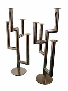 "Pair Hagenauer Candlesticks >>>  This pair of Austrian art deco candlesticks was designed by Karl Hagenauer (1888 – 1956) in the 1930's and made by the Hagenauer Wersktatte in Vienna. Cosntructed of chromium plated brass, the tree form candelabra are stamped ""wHw"" (Hagenauer Wekrstatte Wein)."