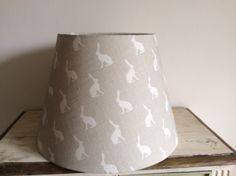 Tapered, drum lamp shade with hare design