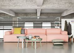 Coral-ish pink couch in a gray room