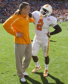 ADAM BRIMER/NEWS SENTINEL Tennessee head coach Butch Jones, left, shares a moment with wide receiver Pig Howard after the Orange and White game at Neyland Stadium on Saturday.