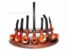 7 New Wooden Pipes Stand-Showcase, Rack Holder for 7 Tobacco Smoking Pipes . Handmade.....LIMITED Edition...... $39.95, via Etsy.