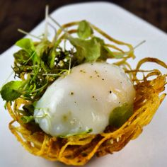 Soft Poached Egg, Potato Nest, Caramelized Onion and Pancetta Vinaigrette