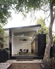 black-white-facade-patio-wood-stoop-outbuilding-fence-ChristopherPollyArchitect-gardenista