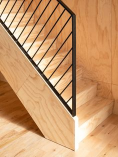Photo 13 of 16 in A Plywood Box Turns a Duplex Into a Multigenerational Home - Dwell Staircase Metal, Modern Stair Railing, Stair Railing Design, Wood Railing, Home Stairs Design, Stair Handrail, Metal Railings, Staircase Railings, Wooden Staircases