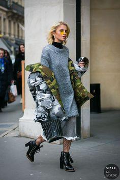 Caroline Daur in a Vetements jacket, Jil Sander sweater and Paco Rabanne bag