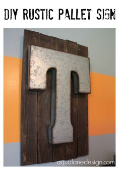 DIY Rustic Pallet Sign Made from old pallets and metal letter from Hobby Lobby aqualanedesign.com. This is perfect for that old wood and the J I have! :)