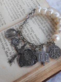 Religious silver charm bracelet crucifix jewelry pearl vintage assemblage Atelier Paris on Etsy Connie Foster sacred heart  mary Jesus cross