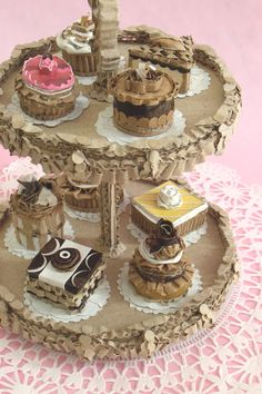 """""""Two Tiered Victorian Dessert Tray"""". 100% recycled cardboard, gesso,  recycled steel rod. Sold."""