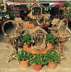 How cool are these rustic plant stands? Imagine them dripping with ferns or bursting with colorful baskets. Line them with coco fiber or moss for a naturalistic planter, maybe even set up a spot for the birds under the roof!