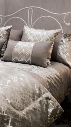 Add a touch of glamour to your bedroom with this stunning Shimmer duvet set. Featuring a soft, satin feel cover detailed with a faux velvet silver panel with a metallic pattern and luxury silver diamante. This pattern is transferred to the pillowcases. Perfect for any monochrome lovers bedroom!