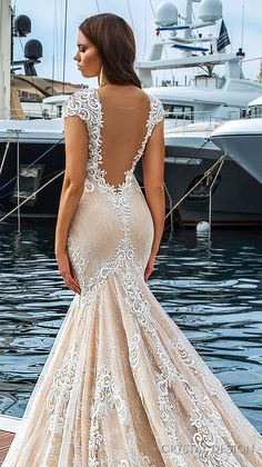 Crystal Design 2017 bridal cap sleeves deep plunging v neck full embellishment ivory color sexy elegant fit and flare mermaid wedding dress low back royal long train (marchesa) zbv #bridal #wedding #weddingdress #weddinggown #bridalgown #dreamgown #dreamdress #engaged #inspiration #bridalinspiration #weddinginspiration #weddingdresses