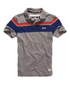 Superdry men's Twin Stripe Hit polo shirt. A classic polo shirt featuring a large 3 colour stripe design across the shoulders and a luxury velvet lined collar. The Twin Stripe polo is finished with an embroidered Superdry chest logo and a 'Superdry Polo Store' patch above the hem.