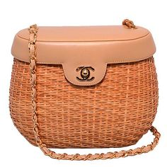 Chanel Tan Leather and Wicker Basket Shoulder Bag | From a collection of rare vintage shoulder bags at https://www.1stdibs.com/fashion/handbags-purses-bags/shoulder-bags/: