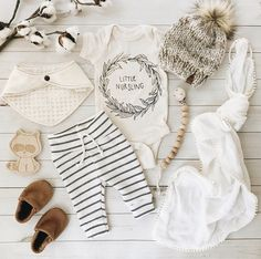 Little nursling onesie bodysuit for baby boy girl newborn. Breastfeeding Baby clothes. Organic cotton. Striped baby legging. Pom crochet beanie. Baby blanket. Wood pacifier clip. Wood baby toys. Brown Baby moccasins. Bibdana. Baby flatlay by figs and foxes.
