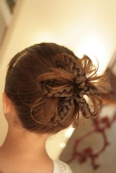 Braid flower, see the how-to here: http://shedoeshair.blogspot.com/search/label/Braids