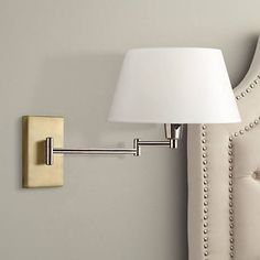 You'll love the elegant look and feel of the design of this stylish Kenroy Element plug-in swing arm wall lamp in vintage brass.