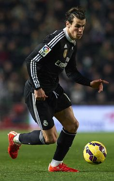 Gareth Bale of Real Madrid runs with the ball during the La Liga match between Elche FC and Real Madrid CF at Estadio Manuel Martínez Valero on February 22, 2015 in Elche, Spain.