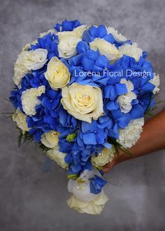 Drop falling bouquet with blue hydrangea, lisianthus and white roses.