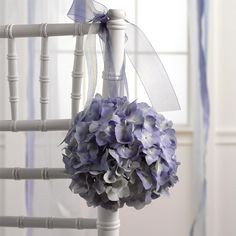 Silk floral aisle decoration or head table chair decor would be an easy DIY