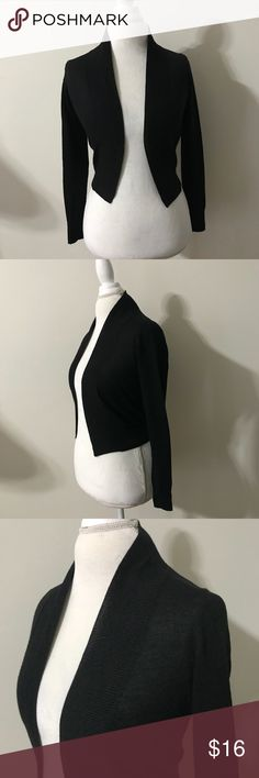 Michael By Michael Kors Black Long Sleeve Shrug Black long sleeve shrug in great shape size PP! Made of 60% ramen and 40% rayon. Cardigan length is 17 inches, across the chest is 18 and the sleeve length is 18.5. MICHAEL Michael Kors Sweaters Shrugs & Ponchos