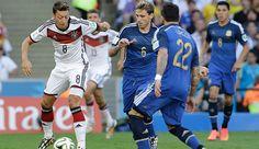 Mesut Özil takes on a few Argentinian defenders.