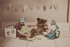 Cutting leaf tobacco. Hand colored photographs capture Japanese life during the Meiji Period, 1890, taken by Japanese photographer, Kusakabe Kimbei.