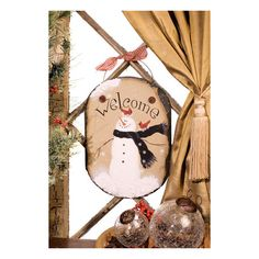 """Two red cardinals adorn the head of an adorable fluffy snowman perched on their snowflake-filled nest. Made of genuine hand-painted slate with wire hanger. Indoor use only. Dimensions: 11.25""""T x 8""""W x"""