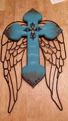 Handcrafted cross with iron angel wings by MorgansCustomCrosses
