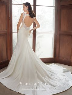 Sophia Tolli | Style No. › Y21519 | For an enchanting wedding day, sleeveless trumpet dream taffeta gown Sawyer features an illusion bateau neckline, an asymmetrically draped bodice and a slimming flared skirt. Hand-beaded lace appliqués adorn the shoulder straps and frame the faux V-neck sweetheart bodice and keyhole back. A chapel length train with matching lace appliqués and a back zipper trimmed [...]