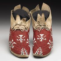 A PAIR OF CHEYENNE PICTORIAL BEADED HIDE MOCCASINS  c. 1900