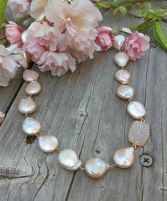Gorgeous Peach Coin Pearls, each measuring about 12mm in diameter, are linked by hand with 14K Gold Filled wire.