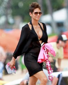 The Call actress looked perfect while on the beach in Hawaii with husband Olivier Martinez. The former Bond girl, wearing a black bikini and chic cover-up, proved she can still work a sexy beach strut.