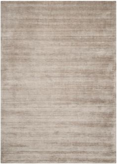 MIR801D Rug from Mirage collection.  Mirage evokes images of Hollywood glamour, with its sophisticated tone on tone pattern created in organic viscose yarn that emulates the look and feel of s